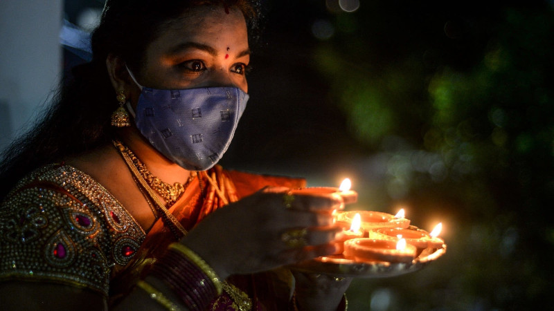 [Celebrating Diwali wearing a mask]
